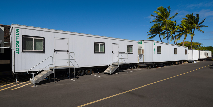 Mobile office trailers lined up with steps installed