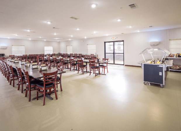 Cafeteria furnished with tables and chairs