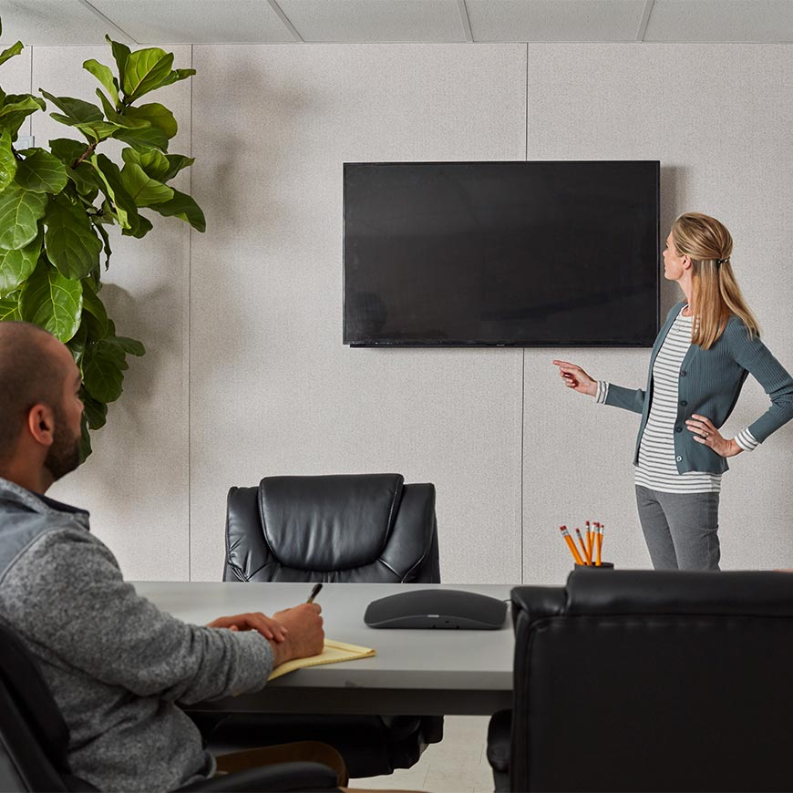 woman presenting in a conference room inside of a mobile office